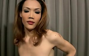Skinny redhead ladyboy with low deck stuff and nonsense tugs two cocks