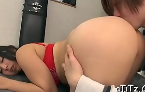 Breasty japanese darling arouses with wicked titty fuck