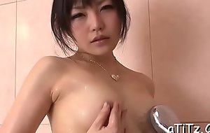 Downcast japanese with expansive hooters plays with a sex toy