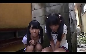 Two petite japanese gals sucking a dick