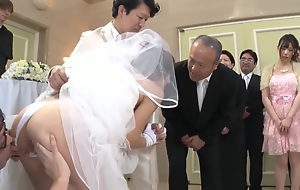 Worn out Man Takes Bride In Japanese Wedding 1